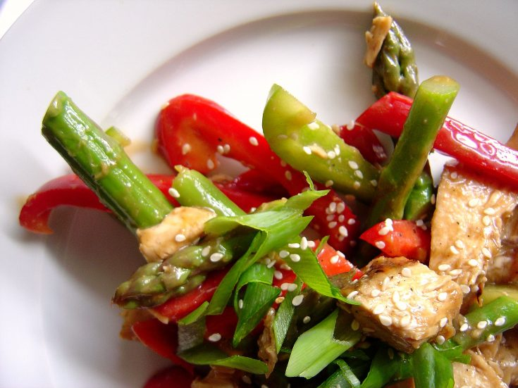 Chinese chicken salad is always a winner for hot summer nights with its sweet and savory honey, soy sauce, peanut butter dressing that perfectly coats a healthy combo of grilled chicken, crisp asparagus, and sweet red peppers. #chicken #salad #asparagus #redpepper #peanutbutter #dressing #honey #soysauce #chinese #asian #weeknight #summer #grilledchicken #grilling #inagarten #barefootcontessa