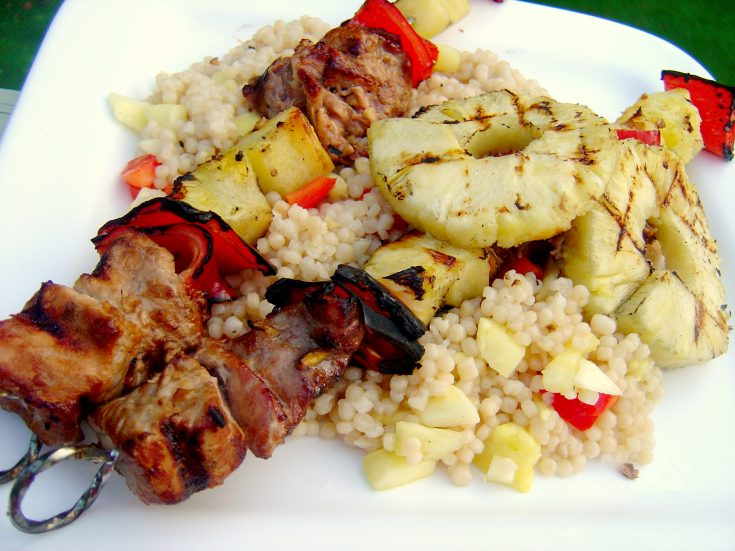 Gingered pork, pineapple and pepper skewers: Lean pork tenderloin marinated in ginger, garlic, and soy sauce and then grilled with pineapple and peppers. #pork #skewers #kabobs #pineapple #peppers #grill #grilling #summer #spring #weeknight #marinated #asian #ginger