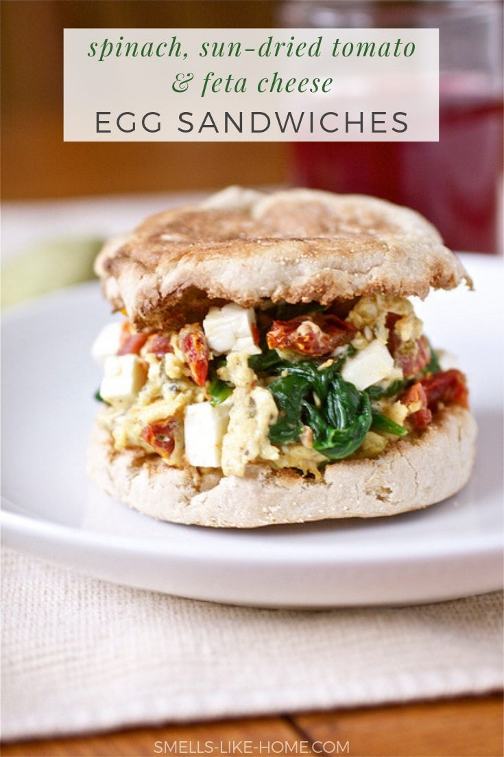Spinach, Feta and Sundried Tomato Egg Sandwiches - Quick, healthy, and super satisfying - what more could you ask of breakfast? #breakfast #egg #sandwiches #scrambledegg #weightwatchers #homemade #healthy #greens #fresh #spinach #sundried #tomato #feta #cheese #onthego #makeahead #quick #easy #englishmuffin #vegetarian #meatless