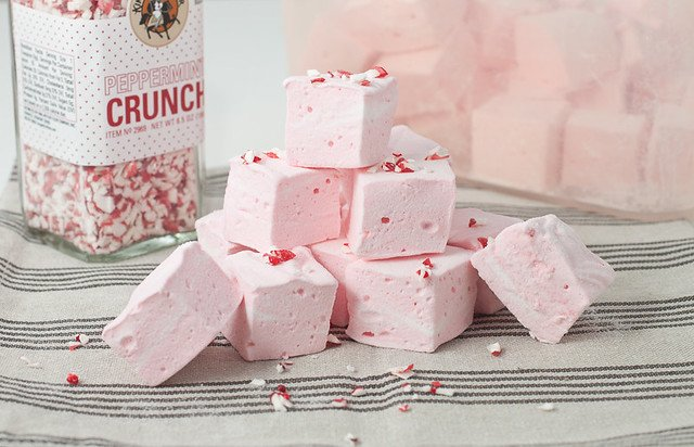 Stack of Peppermint Marshmallows topped with crushed candy canes.
