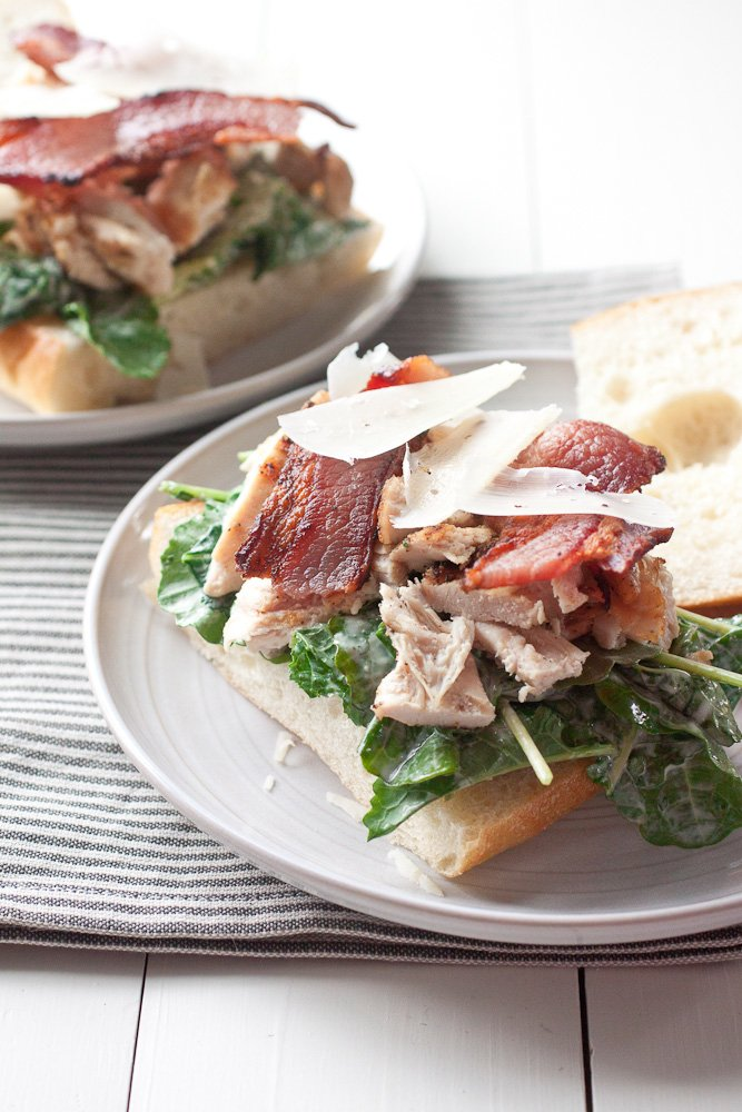 Grilled Chicken Caesar Salad Sandwiches with kale and bacon on ciabatta bread.
