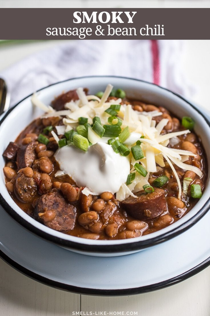 Smoky Sausage and Bean Chili: Chocked full of smoky sausage and hearty navy beans, this chili's got a little kick that makes it cozy, comforting, and completely addictive! #chili #chilirecipe #crockpot #slowcooker #chiliwithbeans