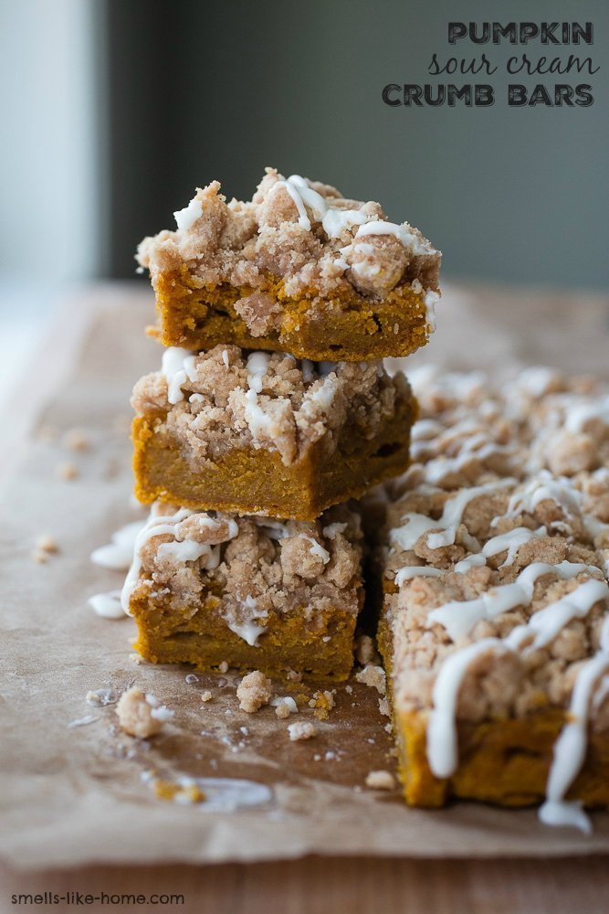 Pumpkin Sour Cream Crumb Bars- The next level of crumb bars: Pumpkin Sour Cream Crumb Bars with pumpkin pie spice, tangy sour cream, and voluptuous crumbs all drizzled with a sugary glaze before serving. #fall #pumpkin #sourcream #bars #crumbbars #dessert #baking #homemade #autumn #spiced #crumbcake #thanksgiving
