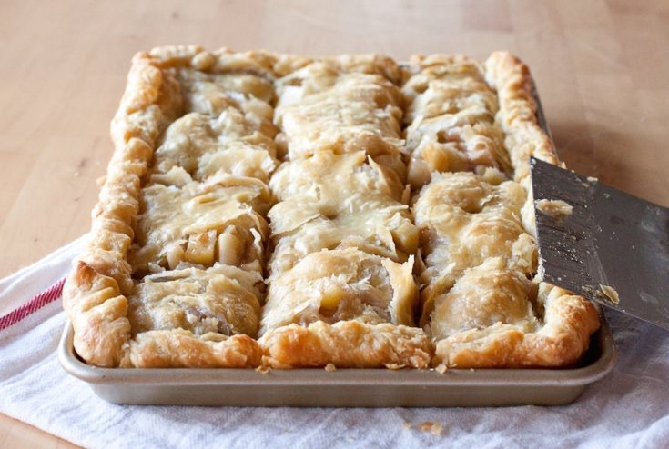 Apple slab pie is party pie. It's an apple pie baked on a large baking sheet and served in squares. What could possibly be better?! #apple #slab #pie #party #sheetpan #jellyroll #pan #pieforacrowd #smittenkitchen #fall #baking #thanksgiving #christmas #summer #4thofjuly #july4th #bbq #potluck #homemade #fromscratch #allbutter #piedough #video #howto