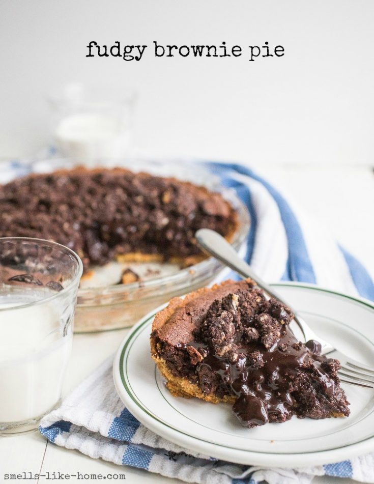 Milk Bar Fudgy Brownie Pie: If you've never made brownies in any other shape than a square or rectangle, you need to get on the brownie pie train. Because this fudgy brownie pie, with its hot fudge sauce and chocolate crumb toppings is bound to be a game-changer in your brownie world. #dessert #homemade #brownie #pie #fudgy #chocolate #fudge sauce #piday #chocolatecrumbs #milkbar #christinatosi