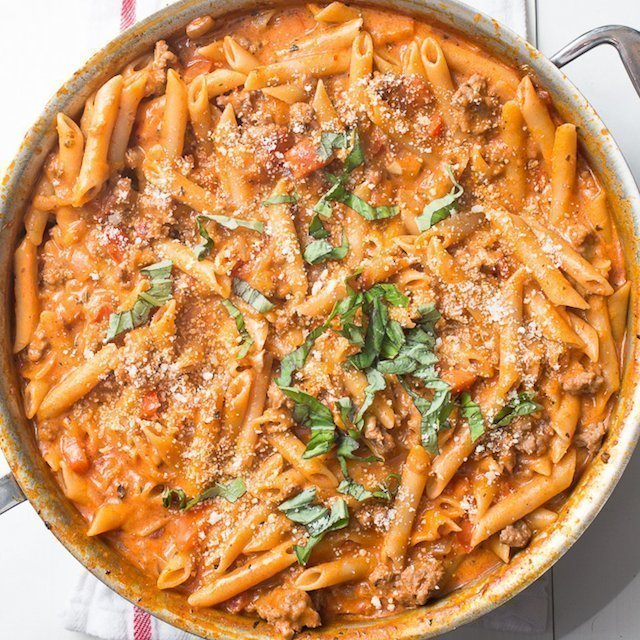 One Pot Creamy Sausage Pasta: An irresistible 30 minute one pot pasta recipe filled with spicy Italian sausage and a silky tomato cream sauce. #onepotpasta #sausagepasta #skilletpasta #onepot #creamypasta