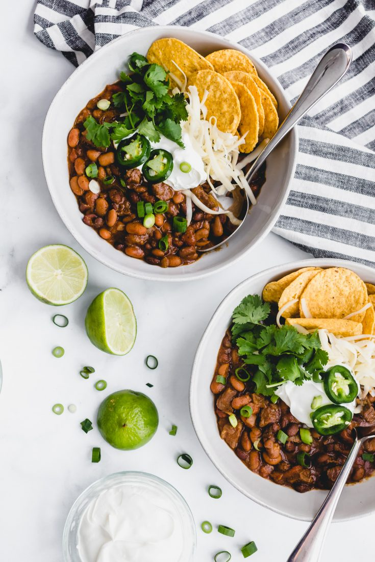 Chili Con Carne with Black and Pinto Beans: A thick and hearty chili loaded up with chunks of beef and 2 kinds of beans. So very unTexas-like and perfect for lazy weekend cooking! #chili #chiliconcarne #beef #weekend #SuperBowl #gameday #tailgaiting #football #party #food #blackbeans #pintobeans #crockpot #slowcooker #stovetop #cozy