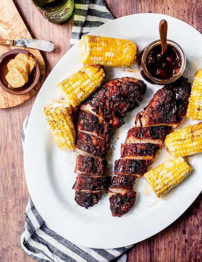 Bourbon peach BBQ grilled pork tenderloin is the perfect way to cook a pork tenderloin. The BBQ sauce, with it's sweet peaches and smoky bourbon flavor, adds a rich glaze to the pork, leaving it utterly irresistible. #grilled #pork #tenderloin #BBQ #bourbonpeach #BBQsauce #summer #entertaining #recipe