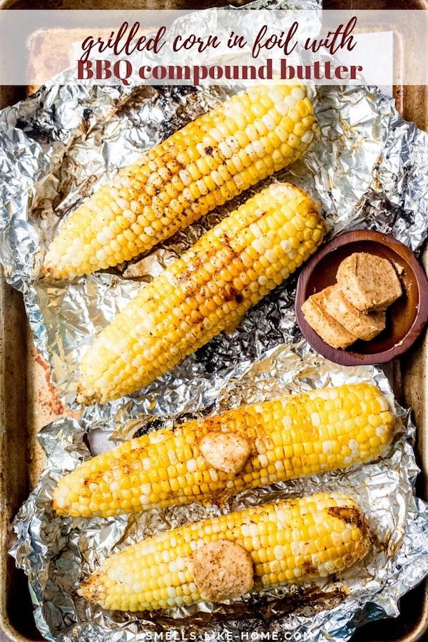 Grilled Corn in Foil with BBQ Compound Butter: Grilled corn steamed in a foil packet with a crazy delicious BBQ spiced compound butter. This is the BEST way to grill corn!!! #grilledcorn #grilledcorninfoil #foilpacketgrilledcorn #grilledcornwithbutter #bbqgrilledcorn