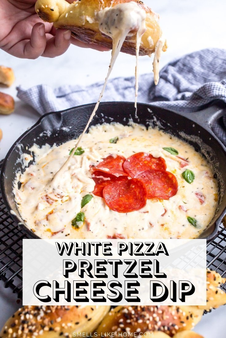 White PIzza Pretzel Cheese Dip: TONS of cheese, pepperoni, garlic, and herbs make the BEST dip for the ulitmate cheese pull! Perfect for dipping soft pretzels, chips, crackers, or veggies, we LOVE this dip for parties! #pizzadip #cheesedip #pretzeldip #Superbowlsnacks #glutenfreedip