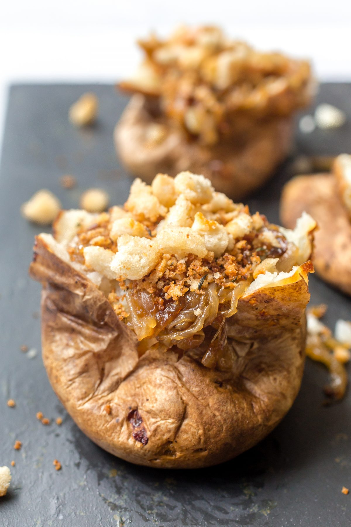 French onion soup loaded baked potatoes topped with crunchy breadcrumbs
